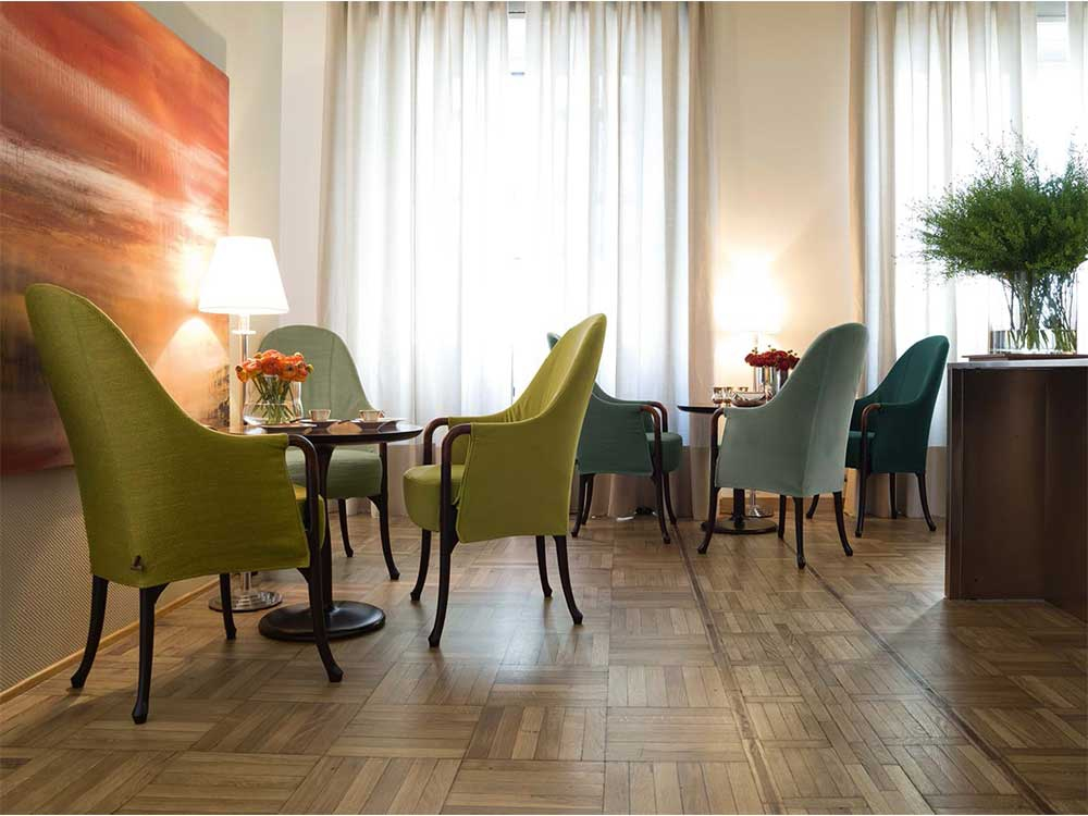 Giorgetti-Progetti-fauteuil-groen-blauw-stof-hout